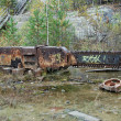 Large saw in neglected talc quarry - Stock Photo
