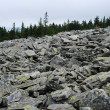 Stones on the flank of hill — Stock Photo