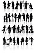 Construction workers silhouettes — Stockvektor