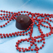 Chocolate and red beads — Stock Photo #1780471