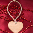 Wooden heart and red beads - Foto de Stock  