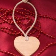 Stock Photo: Wooden heart and red beads