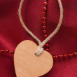 Wooden heart and red beads — Stock Photo #1859062
