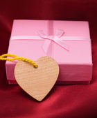 Wooden heart and gift — Stock Photo