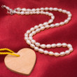 Pearls and heart — Stock Photo