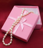 Pearls at pink box — Stock Photo