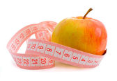 Pink measuring tape and apple — Stock Photo