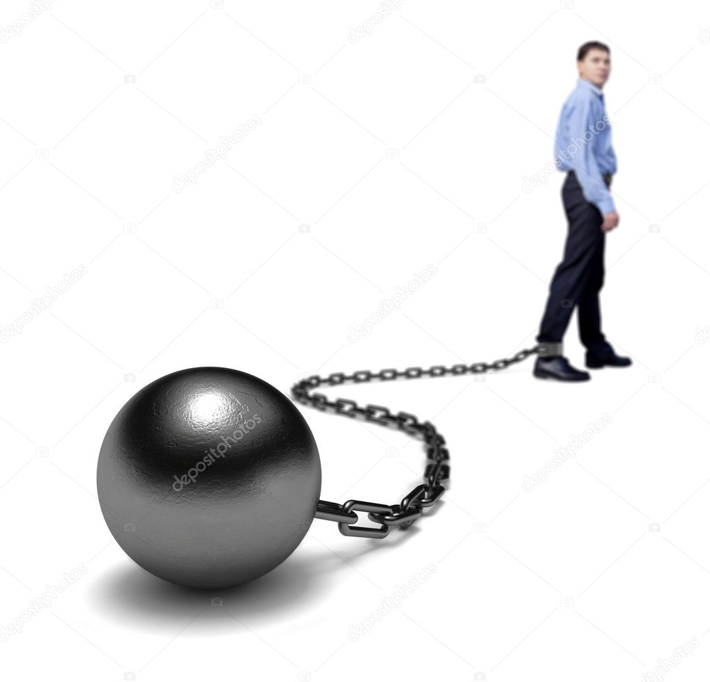 Man's legs dragging a ball and chain, selective focus. — Stock Photo #1074168