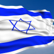 Israeli Flag waving on wind - Stock Photo
