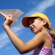 Girl with paper plane — Stock Photo #1092977