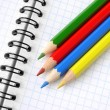 Stock Photo: Pencils and notepad
