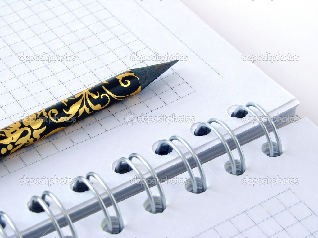 Decorative pencil on spiral notebook page  Stock Photo #1098980