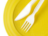 Yellow disposable plate — Stock Photo