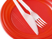 Red disposable plate — Stock Photo
