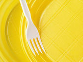 Yellow disposable plates — Photo
