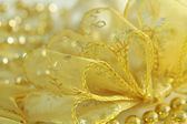 Gold christmas bow — Stock Photo