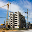 Construction of residential houses, cran - Stock Photo