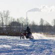Race on a motorcycle in the winter - Stock Photo