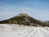 Winter mountain road — Stok fotoğraf