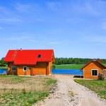 Cottage, lake, blue sky — Stock Photo