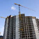 Crane at a construction site, a blue sky — Stock Photo