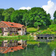 Stock Photo: Mansion by Lake