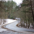 Winding road in winter — Stockfoto