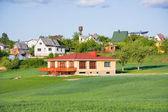 House, lawn, blue sky — Stockfoto