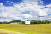 Rural landscape with blank billboard — Stock Photo