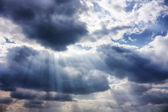Dramatic sky with sunbeams — Stock Photo