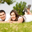 Stock Photo: Beautiful young Couple lie down on grass