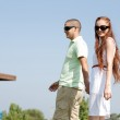 Young couple walk on the park — Stock Photo