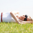 Royalty-Free Stock Photo: Women lie down on grass