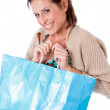 Stock Photo: Women smiling with shopping bag