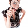 Women looking with magnifying glass — Stock Photo