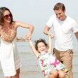 Young couple enjoying with kid — Stock Photo