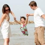 Young couple enjoying with kid — Stock Photo