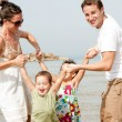 Young couple playing with kids — Stock Photo