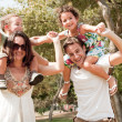 Children sitting on parents shoulders — Foto de stock #1147495