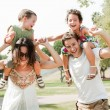 Children enjoying with parents - Stock Photo
