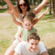 Parents embracing with kids — Stock Photo