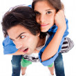 Young man piggy back his girlfriend — Stockfoto