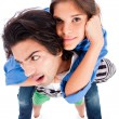 Royalty-Free Stock Photo: Young man piggy back his girlfriend