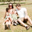 Stock Photo: Couple and enjoy with two children