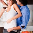 Royalty-Free Stock Photo: Couple enjoying their love in kitchen
