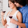 Couple drinking at kitchen — Stock Photo