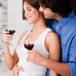 Couple drinking at kitchen — Stock Photo #1147989