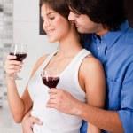 Couple drinking at kitchen — Stock Photo