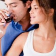 Honeymoon couple drinking wine — Stockfoto
