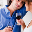 Foto Stock: Man looking his wife with wine